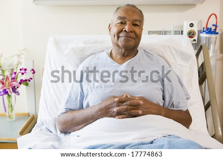 Senior Man Sitting In Hospital Bed - stock photo