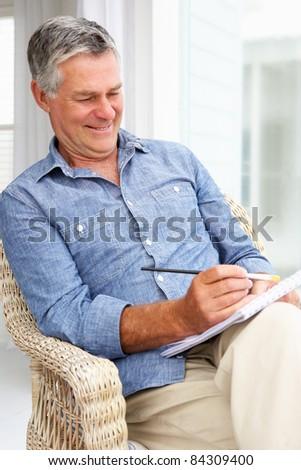 Senior man sketching - stock photo