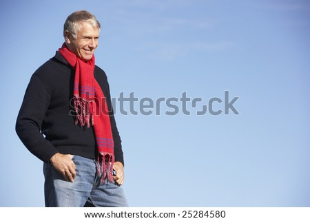 Senior Man Standing In Park