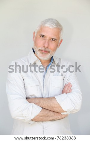 Senior man standing on white background