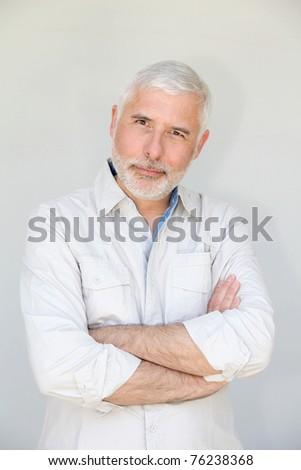 Senior man standing on white background - stock photo
