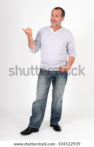 Senior man standing on white background and pointing at message - stock photo