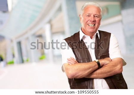 Senior Man Standing With Arms Crossed, Outdoor