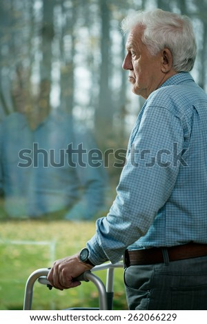 Senior man suffering from depression in old age - stock photo