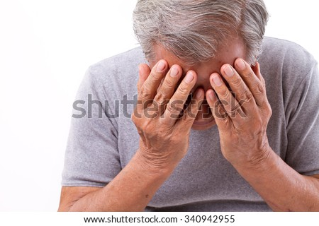 senior man suffering from headache, stress, migraine