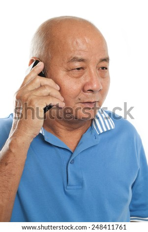 Senior man talking to cellphone. Isolated on white background. - stock photo