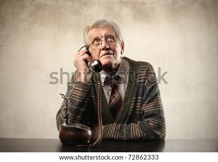 Senior man talking to telephone - stock photo