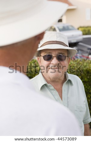 Senior man talking with another senior man - stock photo