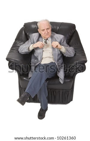 Senior man thinking and sitting in an armchair.