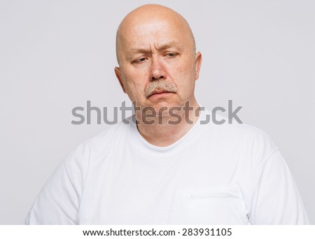 senior man upset portrait with mustache and bald