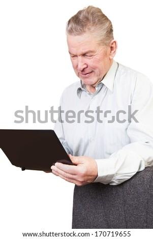 Senior man using laptop. - stock photo