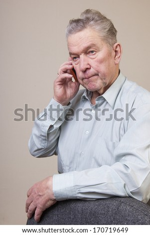 Senior man using phone.