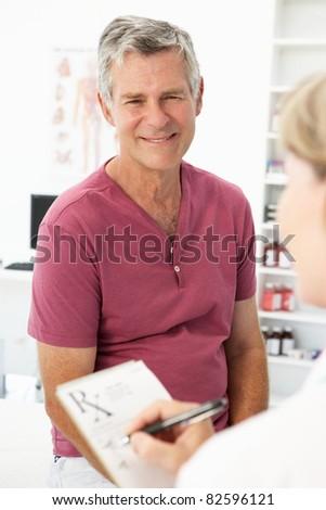 Senior man visiting doctor - stock photo