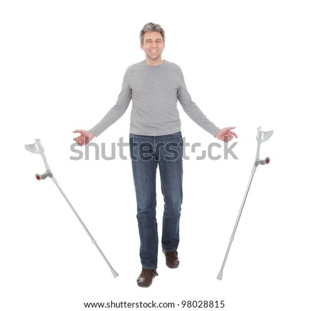 Senior man walking using crutches. Isolated on white - stock photo