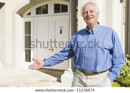 Senior man welcoming visitor to home