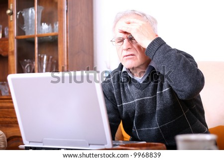 Senior man with a computer problem - stock photo