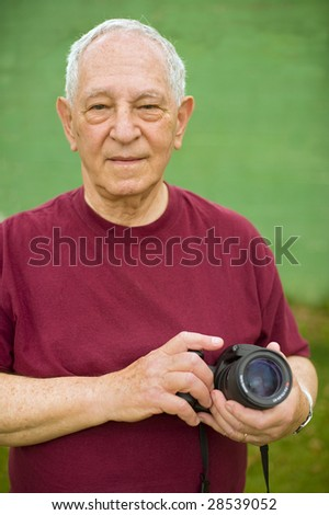 senior man with a digital camera - stock photo