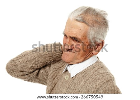 Senior man with a strong pain in the back of his neck - stock photo