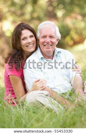 Senior Man With Adult Daughter In Park - stock photo
