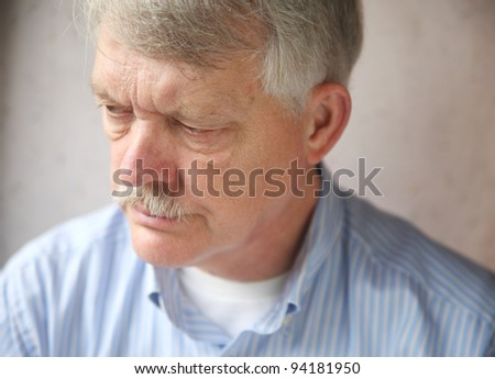 senior man with an angry, troubled expression - stock photo