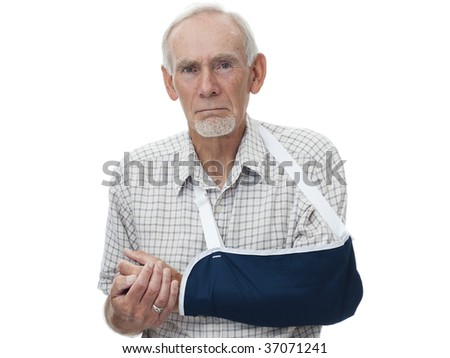 Senior man with arm in sling - stock photo