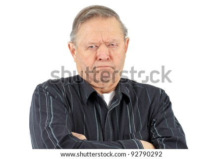 Senior man with arms crossed looking very grumpy, unhappy or mad. - stock photo
