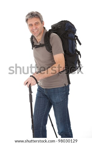 Senior man with backpack and hiking poles. Isolated on white - stock photo