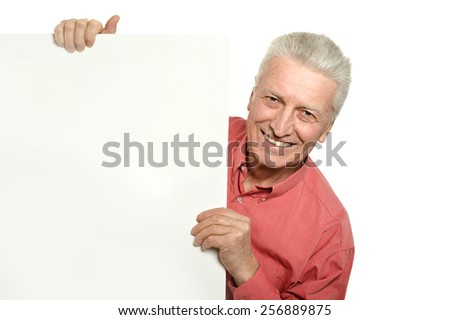 Senior man with blank advertising board or copy space, isolated on white - stock photo