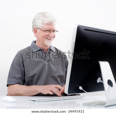 senior man with  computer at home - stock photo