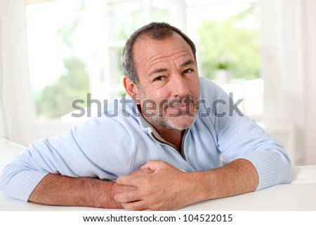 Senior man with doubtful look on his face - stock photo