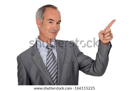 Senior man with finger up on white background