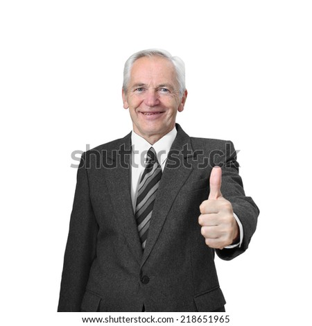 Senior man with friendly smiling face shows raised thumb isolated on white background