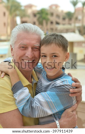 senior man with grandchild at vacation resort