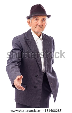 Senior man with hand outstretched  for a handshake isolated on white background - stock photo