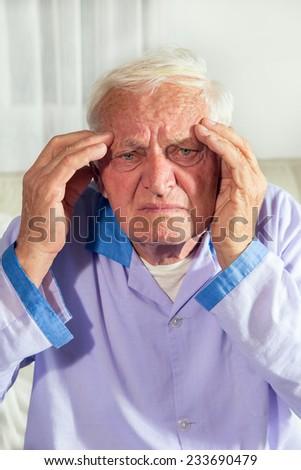 Senior man with headache - stock photo