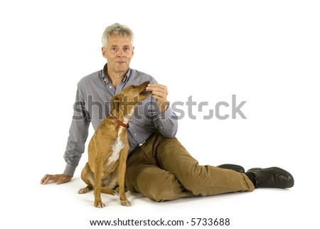 senior man with his crossbreed brown dog - stock photo