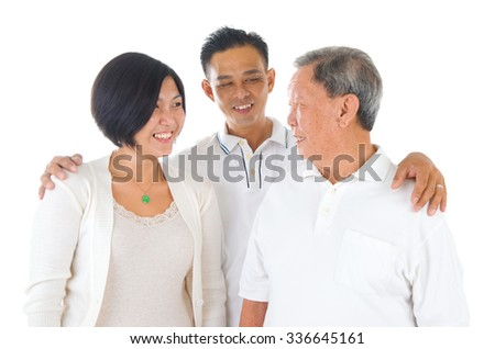 Senior man with his daughter and son. Happy Asian family senior father and adult offspring indoor portrait. - stock photo