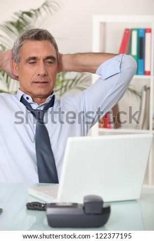 Senior man with his laptop - stock photo
