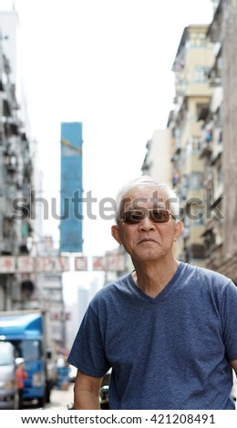 senior man with hong kong urban architecture scene. Travel to experience different place