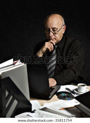 Senior man with laptop - stock photo