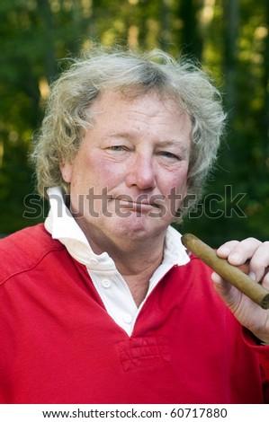 senior man with long hair smoking large cigar - stock photo