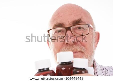 Senior Man with medicine bottles - stock photo