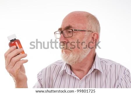 Senior man with pill bottle - stock photo