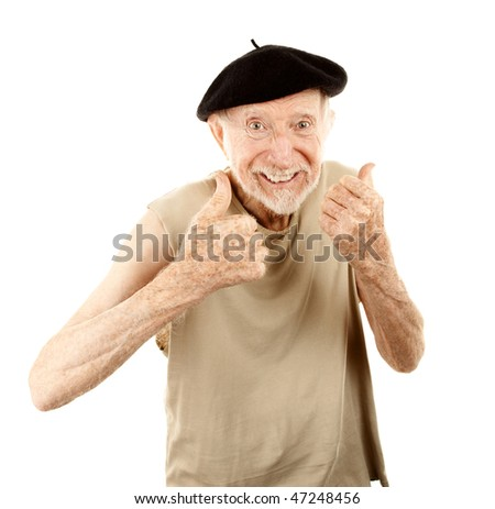 Senior man with pleasant expression wearing beret - stock photo