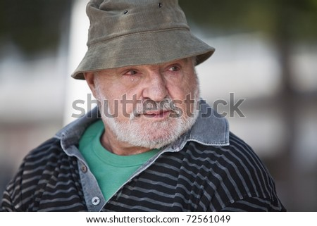Senior man with tear running down face