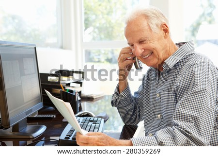 Senior man working at home - stock photo