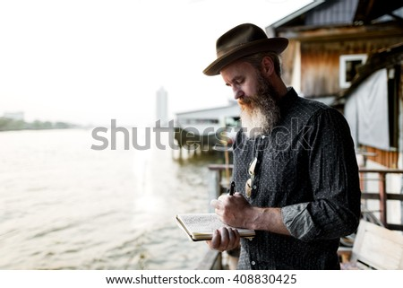 Senior Man Writing Notebook Commuter Traveling Concept - stock photo
