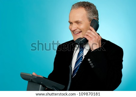 Senior manager discussing deal with client over a phone call