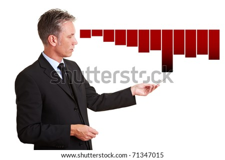 Senior manager explaining financial losses with a chart - stock photo