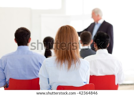 Senior manager giving a presentation in the office - stock photo